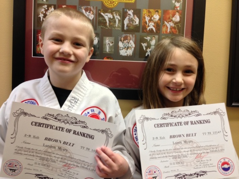 Laney and her big-brother Landon, holding their Brown Belt Certifications. She smiles and on the inside, she is screaming!
